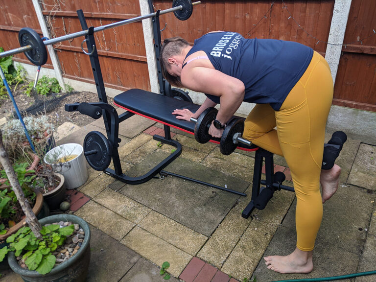 Jem wearing yellow ADFIT leggings doing bent over row