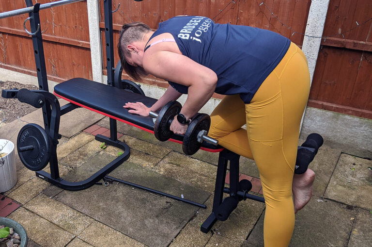 Jem wearing yellow ADFIT leggings doing bent over row